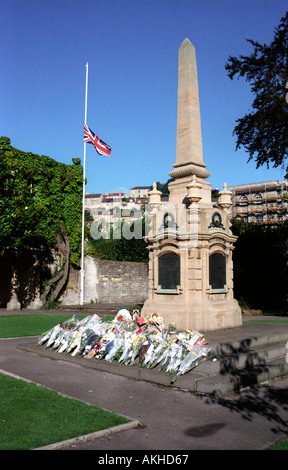 The Union Jack at half mast and floral tributes after the death of Diana Princess of Wales - Stock Photo