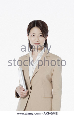 Businesswoman with personal organiser - Stock Photo