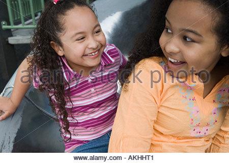 Girls on a slide - Stock Photo