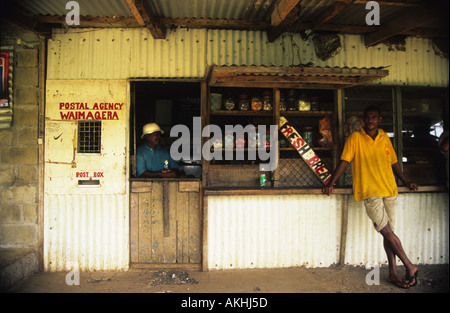 A man stands in front of the local post office, Taveuni Island, Fiji, South Pacific - Stock Photo