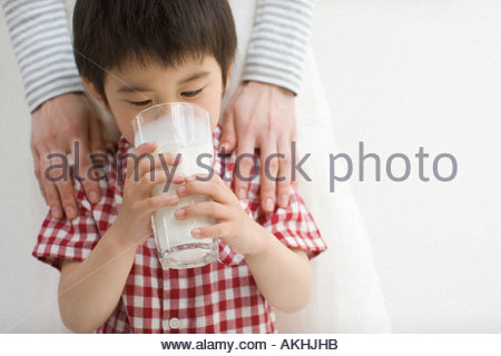 Asian boy drinking milk - Stock Photo