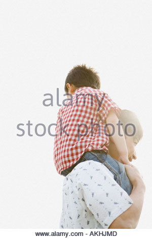 Father shoulder carrying his son - Stock Photo