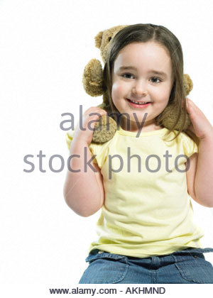 Girl with teddy on her shoulders - Stock Photo