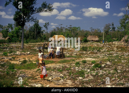Mexican people, Mayan people, drawing water from well in the village of Palacio Gomez in Quintana Roo State in Yucatan - Stock Photo