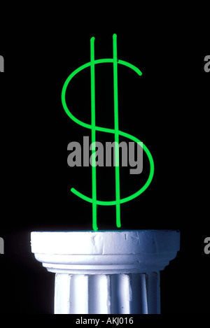 Neon dollar sign on pedestal - Stock Photo
