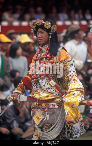 Male Khampa wears tiger skin coral zee stones gold gau boxes at the Litang  - Stock Photo
