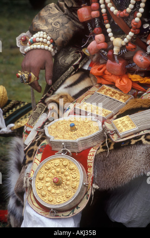 Male Khampa wears leopard skin coral zee stones gold gau boxes at the Litang Horse Festival Sichuan Province China - Stock Photo