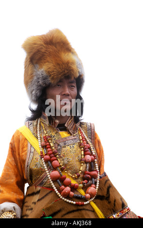 Male Khampa wears coral zee stones fox fur hat tiger skin at the Litang Horse Festival Sichuan Province China Tibet - Stock Photo