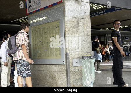 train timetable and passengers in roma termini station rome italy - Stock Photo