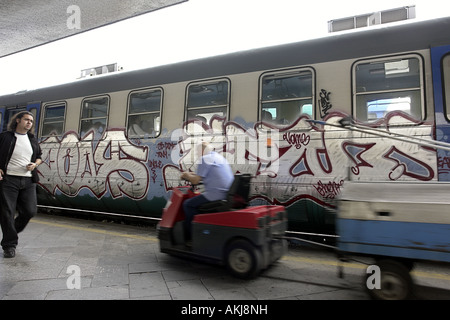 train graffiti and workers in roma termini station rome italy - Stock Photo
