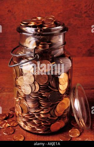 Jar full of pennies - Stock Photo