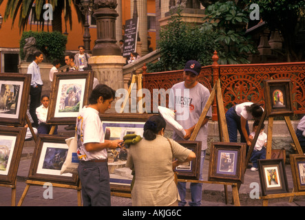 Mexicans, Mexican man, vendor, art fair, selling paintings, paintings for sale, artwork, Guanajuato, Guanajuato - Stock Photo