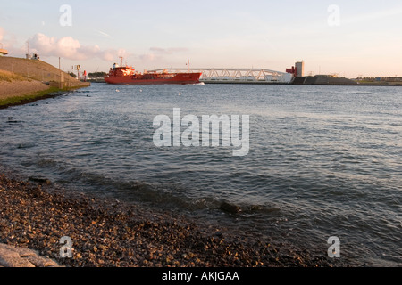 Ship/ Sea vessel passing Maeslant Storm Barrier, Rotterdam harbour, Southern-Holland, The Netherlands - Stock Photo
