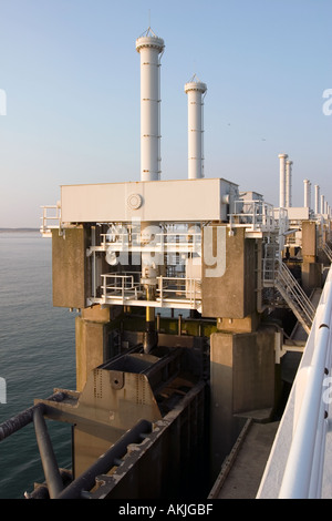 Big hydraulics valves on top of the Storm Barrier to open/close the huge doors in the barrier - Stock Photo
