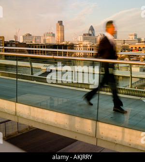Crossing millennium bridge towards bankside London No model release as movement blur side view means person is unrecognizable - Stock Photo