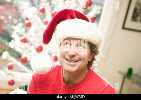Portrait of playful man at Christmastime - Stock Photo
