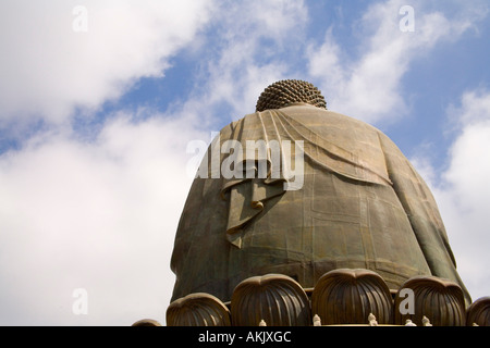 View of back of Buddha statue and sky - Stock Photo