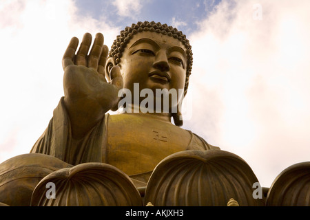 Massive statue of seated Buddha with clouds - Stock Photo