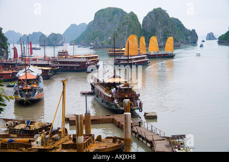 Boats and rocky islands in Vietnamese harbor - Stock Photo