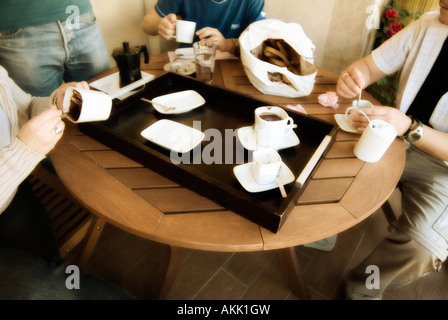 Group of friends having breakfast together