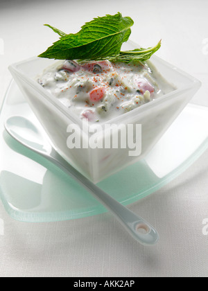 A dish of Indian cucumber and tomato raita vegetarian editorial food - Stock Photo