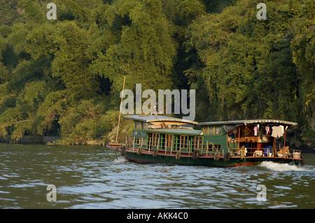 China Guangxi Boat Navigating At Sunset Between Xinping And Yangshuo On Li Jiang River - Stock Photo