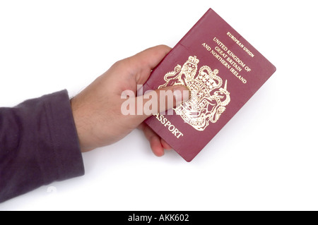 Asian mans hand holding worn out red british eu european union passport on white background - Stock Photo
