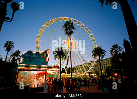 ferris wheel at night - Christmas market in Nice on the Cote d'Azur France 2004 - Stock Photo