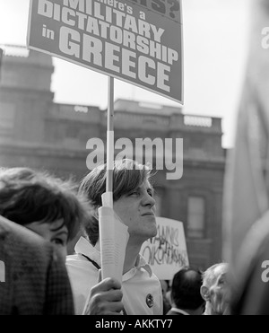 A protester at a 1968 demonstration in Trafalgar Square, London against the military regime in Greece. - Stock Photo