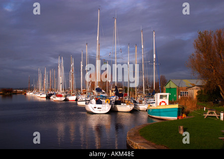 Exeter Canal near Turf Locks with sailing boats and reflections on the water in winter sun Exe estuary near Exmouth - Stock Photo