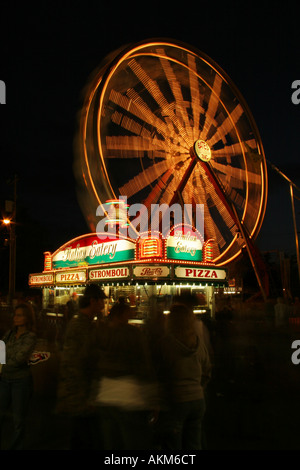 Italian Eatery and Ferris Wheel at Night Canfield Fair Canfield Ohio - Stock Photo