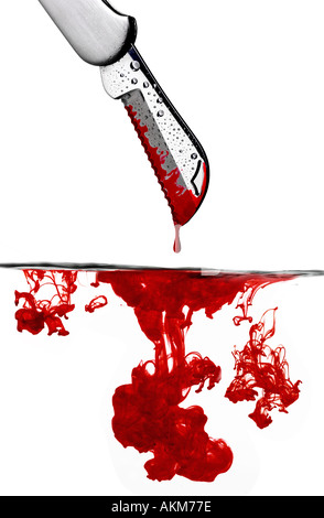 BLOOD STAINED KNIFE DRIPPING BLOOD INTO WATER - Stock Photo