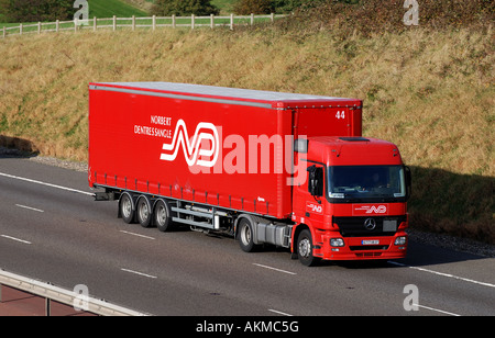 Norbert Dentressangle lorry on M40 motorway, Warwickshire, England, UK - Stock Photo