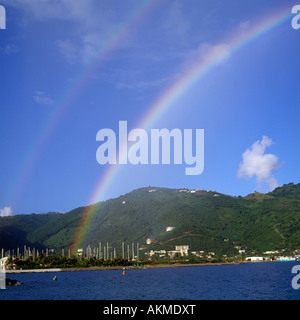 Section of double rainbow over the sea & yacht harbour at Road Town with hills beyond Tortola Island the British - Stock Photo