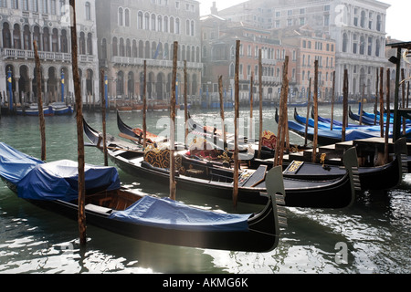 Gondolas moored on the Grande Canal in Venice, Italy in February.