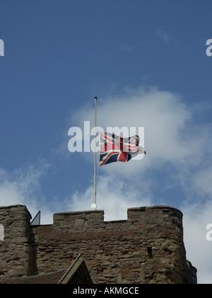 Union Jack Flying at Half Mast Tamworth Castle Staffordshire UK. - Stock Photo