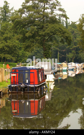Mon and Brecon Canal narrowboats and day cruisers on moorings at Goytre Wharf Monmouthshire South Wales UK - Stock Photo