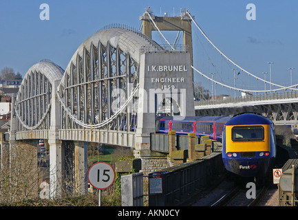 Train crossing the Famous Brunel Royal Albert Bridge into Cornwall - Stock Photo