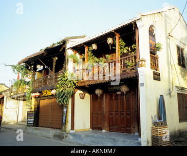 Traditional shophouses in Tran Phu St, early morning, Hoi An, Viet Nam - Stock Photo