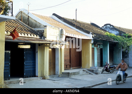 Narrow shophouses in Tran Phu St, early morning, Hoi An, Viet Nam - Stock Photo