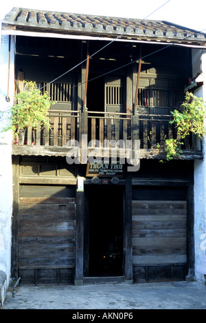 Traditional shop house in Tran Phu St, early morning, Hoi An, Viet Nam - Stock Photo