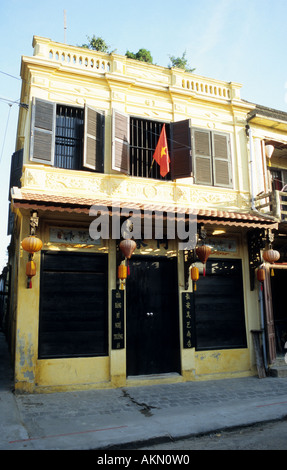 Traditional narrow shophouse in Tran Phu St, early morning, Hoi An, Viet Nam - Stock Photo