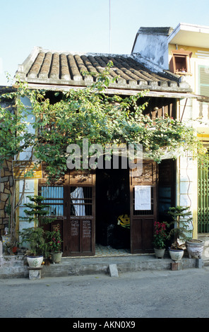 Traditional narrow shophouse restaurant in Tran Phu St, early morning, Hoi An, Viet Nam - Stock Photo