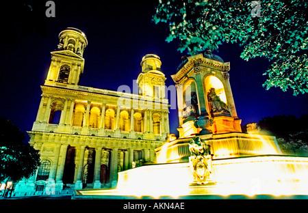 Paris France 'Saint Sulpice Church' Front Lit Up at Night on 'Place St Sulpice' 'Quatre Points Cardinaux' Public - Stock Photo
