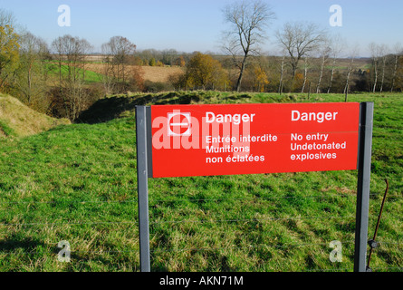 Sign warning of undetonated explosives, World War One battlefield, Somme - Stock Photo