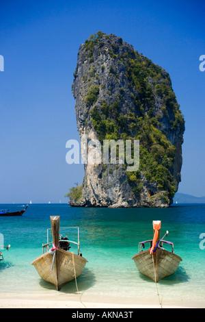 Boats anchored at beach Ko Poda in background Laem Phra Nang Railay Krabi Thailand - Stock Photo