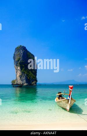 Boat anchored at beach Ko Poda in background Laem Phra Nang Railay Krabi Thailand - Stock Photo