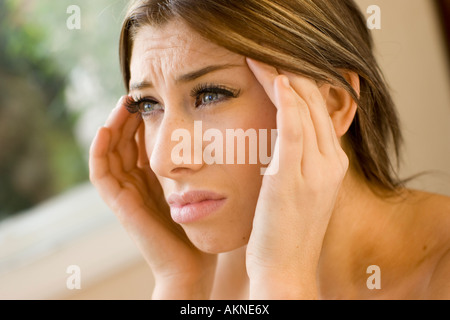 Stressed Girl with hands on her head - Stock Photo