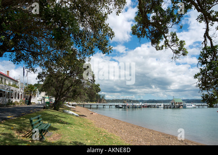 Beach with the Duke of Marlborough Hotel just visible on the left, Russell, Bay of Islands, Northland, North Island, - Stock Photo