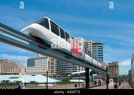 Monorail crossing over Pyrmont Bridge with hotels behind, Darling Harbour, Sydney, New South Wales, Australia - Stock Photo